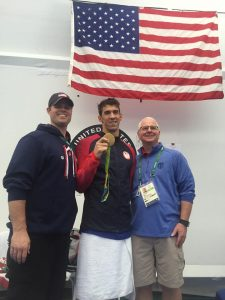 Keenan with Coach Bob Bowman and Michael Phelps after Day 6 of the Olympics, titled Capacity vs Utilization on Keenan's Facebook page